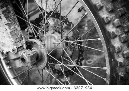 Close up monochrome fragment of front sport motocross bike wheel