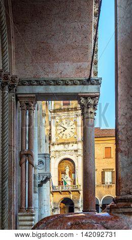 Metropolitan Cathedral of Santa Maria Assunta e San Geminiano and the Palazzo Comunale city hall in Piazza Grande of Modena at sunset. Emilia-Romagna. Italy. stock photo