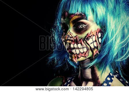 Fashionable zombie girl. Portrait of a pin-up zombie woman. Body-painting project. Halloween make-up