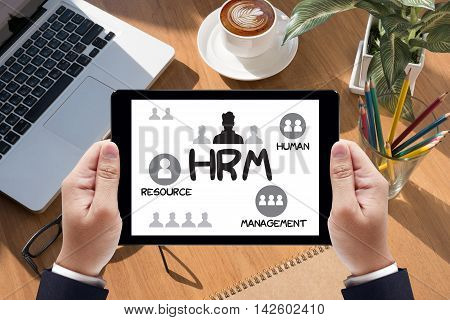 HRM Human Resource Management Strategy Planning Working HRM man Businessman work on tablet on screen stock photo