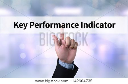 KPI acronym (Key Performance Indicator) Business man with hand pressing a button on blurred abstract background stock photo