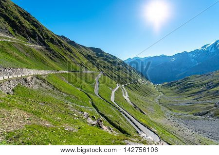 Beautiful sunset about famous road in mountains Alps Passo Stelvio stock photo