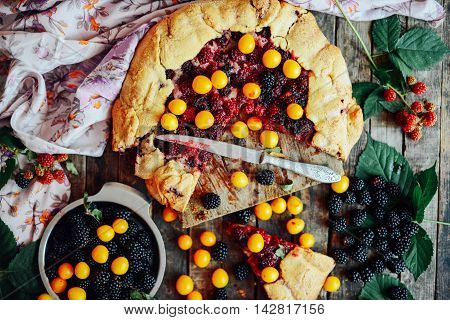 freshly baked berry pie. Blackberries pie with a slice missing. Berry pie preparation. pie in summer with fresh picked blackberries. stock photo
