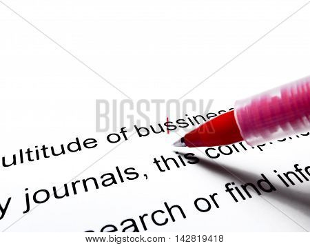 Red pen correcting proofread english text isolated on white stock photo