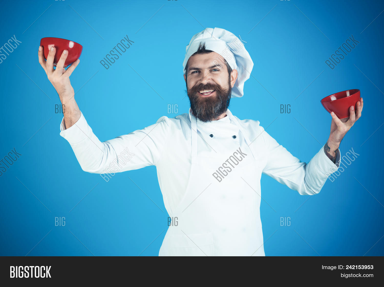 apron,background,beard,bearded,black,body,bowl,burgundy,caucasian,chef,concept,cook,cooking,cuisine,culinary,diet,face,food,green,hair,happy,hat,hold,ingredient,isolated,kitchen,lettuce,macho,male,man,meal,moustache,nutrition,pasta,plate,restaurant,serious,sexy,studio,stylish,uniform,vegetables,vegetarian,white,young