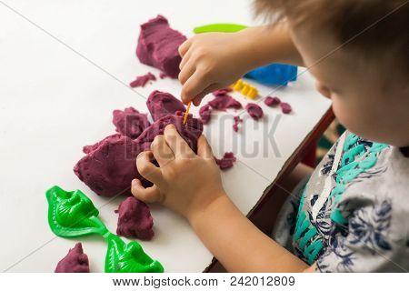 Plasticine molding, the development of fine motor skills in children stock photo