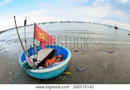 Local fishing boats on the beach in marina at Phat Thiet, Mui Ne, Vietnam stock photo