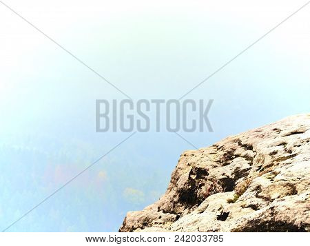High sharp mountain peaks from plane beautiful view. Fantastic dreamy sunrise sharp contour of mountain above mist. stock photo