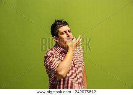 Do not miss. Young casual man wheezing. Shout. Crying emotional man wheezing on green studio background. male half-length portrait. Human emotions, facial expression concept. Trendy colors stock photo