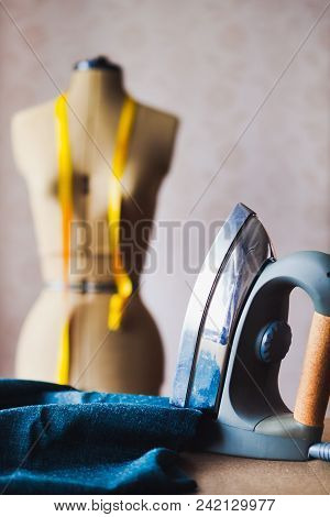 Close up of professional iron in a tailor's factory, tailoring theme, copy space stock photo