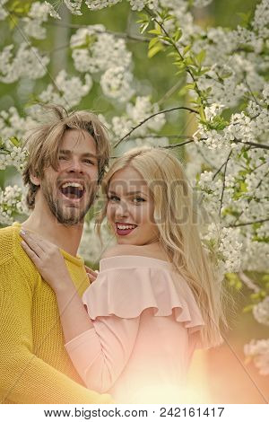 Sexy couple. Couple in love in blossoming flower, spring. Love and romance, relationship, happy couple. Spring, nature, environment. Sensual woman and man in cherry bloom. Man and woman in spring, easter. family stock photo