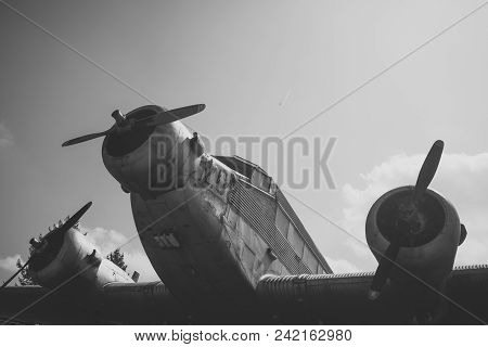 Air forces, aircraft, history, progress, development. Textured grunge old plane, blue sky background. Old plane not able to fly, stands in museum of aviation or garbage dump, recycling center. stock photo
