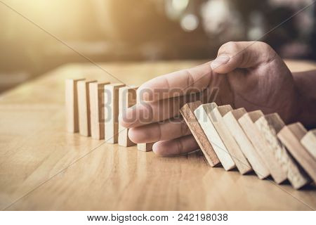 Plan and strategy in business, Risk To Make Business Growth Concept With Wooden Blocks, hand of man has piling up and stacking a wooden block. stock photo