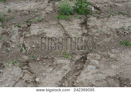 soil erosion on a field - the result of torrential rain stock photo