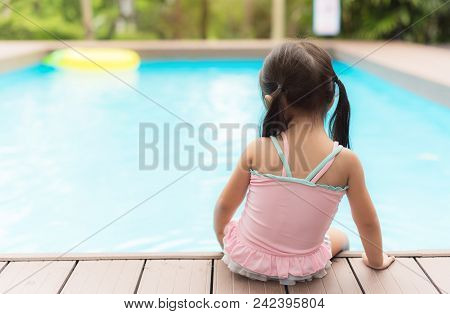 Little girl on watter pool in the summer day. stock photo