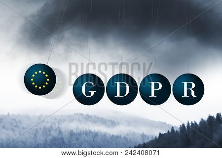 The dark clouds of GDPR approaching. Conceptual image illustrating GDPR regulations using Newton's cradle in a negativemanner stock photo