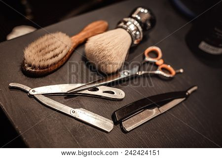 Shaving accessories and tools of barber shop on wooden background stock photo