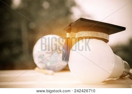 Graduate study, Education knowledge power concept: Hands holding light bulb with Graduated cap. Conceptual for Educational Sparked Navigation for successs study or business world. Back to School ideas stock photo
