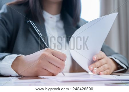 Asian Business Woman Manager Checking And Signing Applicant Filling Documents Reports Papers Company