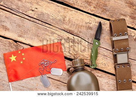 Chineese flag and military travel items. Top view, flat lay. Wooden background. stock photo
