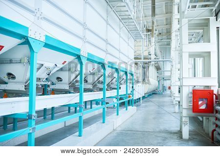 Interior Of Clean Production Workshop At Food Factory, Modern Machine Units Lining Long Hall, Copy S