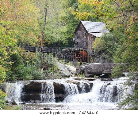 Scenic view of Grist Mill in the Autumn with stream and waterfalls stock photo