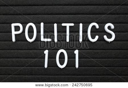 The words Politics 101 in white plastic letters on a black letter board as an introduction to the basics for learning the subject stock photo