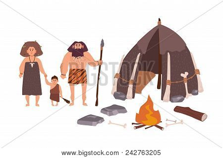 Family of ancient people, cavemen, primitive men or archaic human. Mother, father and son standing beside their dwelling and bonfire. Stone Age cartoon characters. Flat colorful vector illustration stock photo