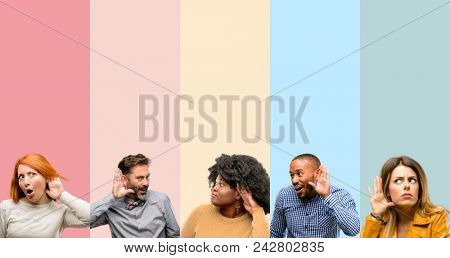 Cool group of people, woman and man holding hand near ear trying to listen to interesting news expre