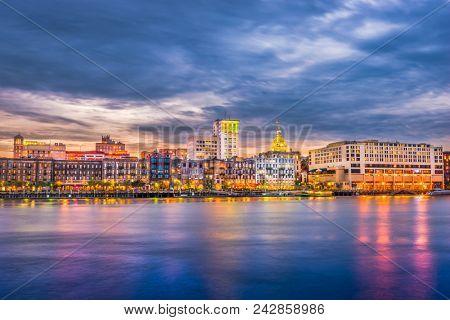 Savannah, Georgia, USA cityscape on River Street at dawn.