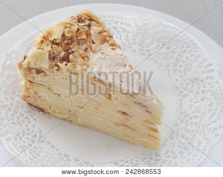 Mille feuille, multi layered cake. Puff pastry cake decorated with crumbs. Russian traditional Napoleon dessert with many layers. Selective focus. stock photo