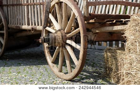 A rural cartwheel near to a haystack stock photo