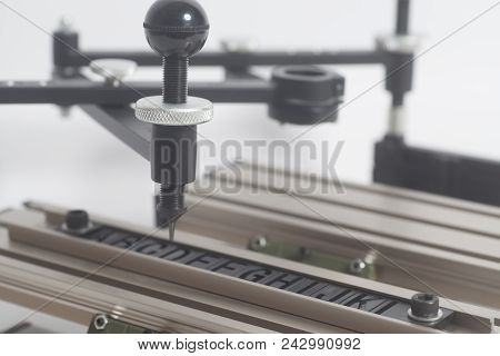 Pantograph engraving device with letterpress alphabet on a white background stock photo