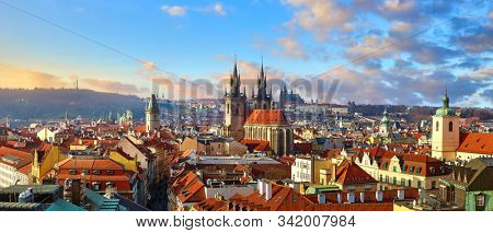 Top view of Prague, Czech Republic. Panoramic view of old town Church of Our Lady Before Tyn and Gothic cathedral on city skyline with scenic sunset and blue sky. Midtown castle red roofs. stock photo