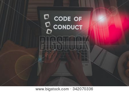 Handwriting text writing Code Of Conduct. Concept meaning Ethics rules moral codes ethical principles values respect. stock photo
