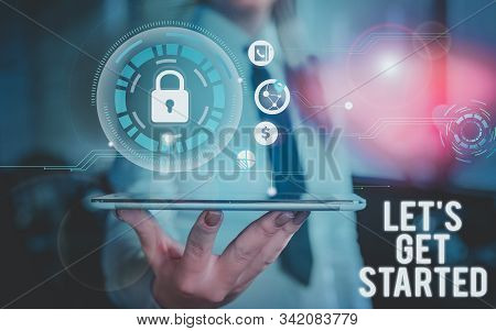 Conceptual hand writing showing Let S Is Get Started. Business photo showcasing to begin doing or working on something you had started Woman wear formal work present using smart latest device. stock photo
