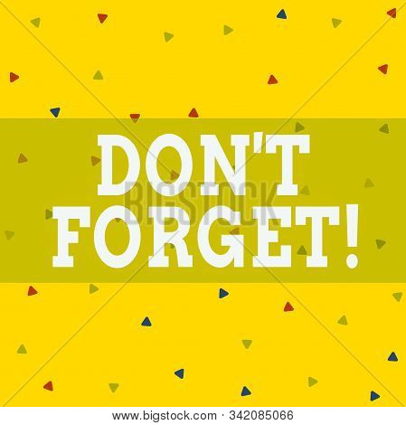 Writing note showing Don T Forget. Business photo showcasing used to remind someone about important fact or detail Triangle Shape Confetti or Broken Glass Scattered Yellow Tone. stock photo