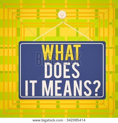Text sign showing What Does It Means question. Conceptual photo asking someone about meaning something said and you do not understand Colored memo reminder empty board blank space attach background rectangle. stock photo