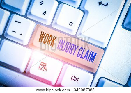Text sign showing Work Injury Claim. Conceptual photo Medical care reimbursement Employee compensation White pc keyboard with empty note paper above white background key copy space. stock photo