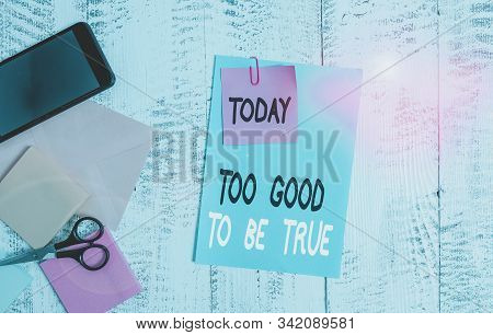 Writing note showing Too Good To Be True. Business photo showcasing Extraordinarily Fantastic but Doubtful Unthinkable Envelope paper sheet smartphone notepads scissors wooden background. stock photo