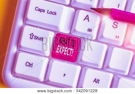 Writing note showing What To Expect. Business photo showcasing asking about regard something as likely to happen occur White pc keyboard with note paper above the white background. stock photo
