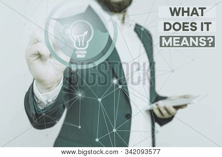 Handwriting text writing What Does It Means Question. Concept meaning asking meaning something said and do not understand Male human wear formal work suit presenting presentation using smart device. stock photo