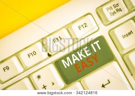 Handwriting text writing Make It Easy. Concept meaning Smart approach Effortless Free from worries or difficulties White pc keyboard with empty note paper above white background key copy space. stock photo