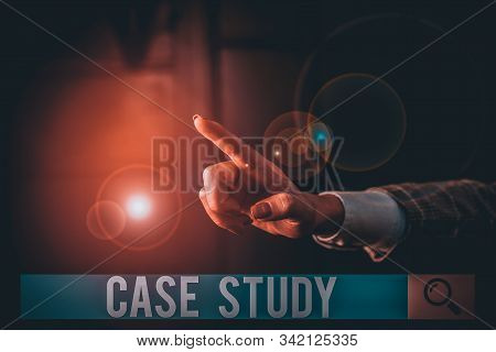 Conceptual hand writing showing Case Study. Business photo text analysis and a specific research design for examining a problem Finger pointing in the Dark with hand pointing in the copy space. stock photo