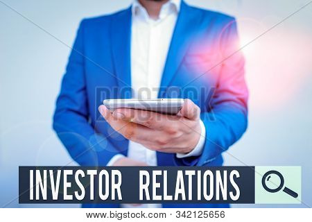 Writing note showing Investor Relations. Business photo showcasing analysisagement responsibility that integrates finance Business concept with man holding mobile phone with touch screen. stock photo