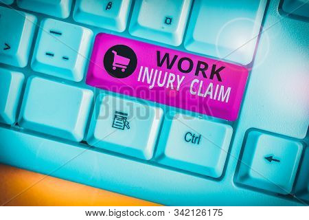 Writing note showing Work Injury Claim. Business photo showcasing Medical care reimbursement Employee compensation White pc keyboard with note paper above the white background. stock photo