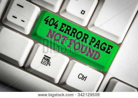 Handwriting text writing 404 Error Page Not Found. Concept meaning Webpage on Server has been Removed or Moved White pc keyboard with empty note paper above white background key copy space. stock photo