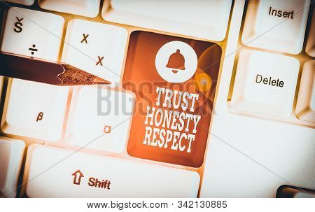 Conceptual hand writing showing Trust Honesty Respect. Business photo showcasing Respectable Traits a Facet of Good Moral Character White pc keyboard with note paper above the white background. stock photo