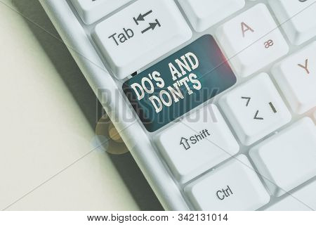 Word writing text Do S And Don tS. Business concept for Rules or customs concerning some activity or actions White pc keyboard with empty note paper above white background key copy space. stock photo