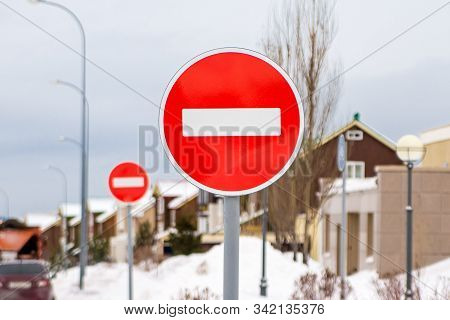 absurdly prohibiting signs for entry and exit from a completely restricted area stock photo